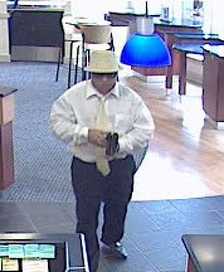 A surveillance photo of the man who robbed a People's United bank in Greenwich on Aug. 28. Photo: Greenwich Time