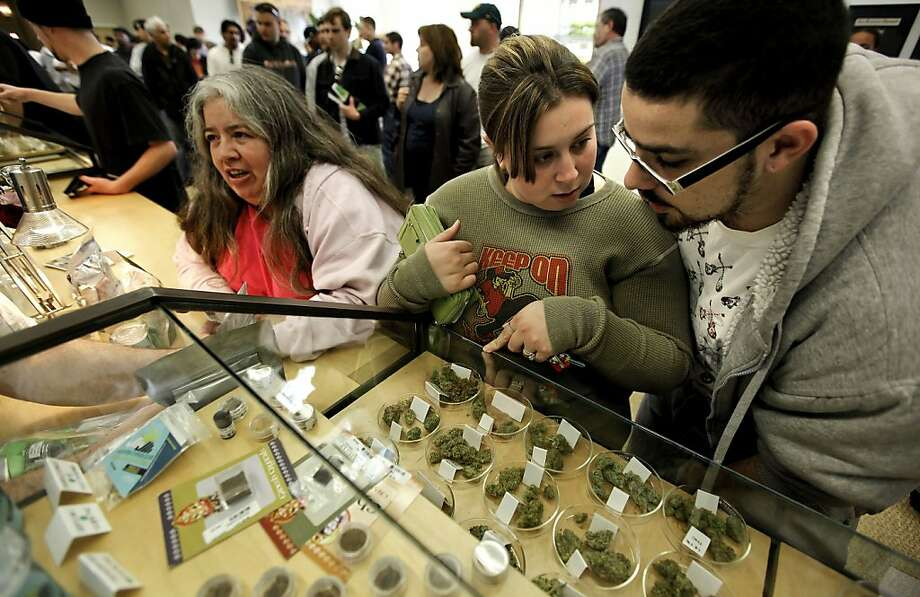 Customers check out the cannabis selection at the largest medical marijuana dispensary, Harborside Health Center, in Oakland. Photo: Michael Macor, The Chronicle