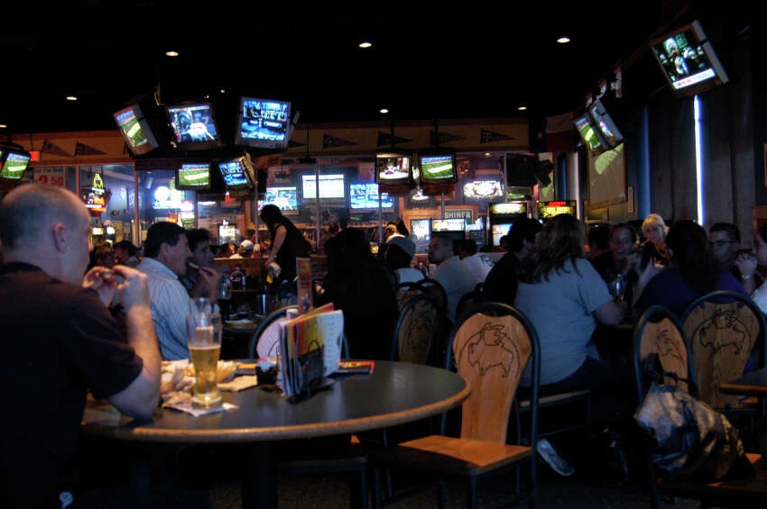 Dozens of flat panels and hanging screens make Buffalo Wild Wings a mecca for sports fans.