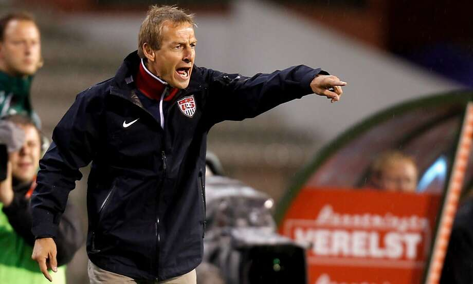 U.S. coach Juergen Klinsmann and his players head into the next round of World Cup qualifiers on a 12-match win streak. Photo: Friedemann Vogel, Bongarts/Getty Images