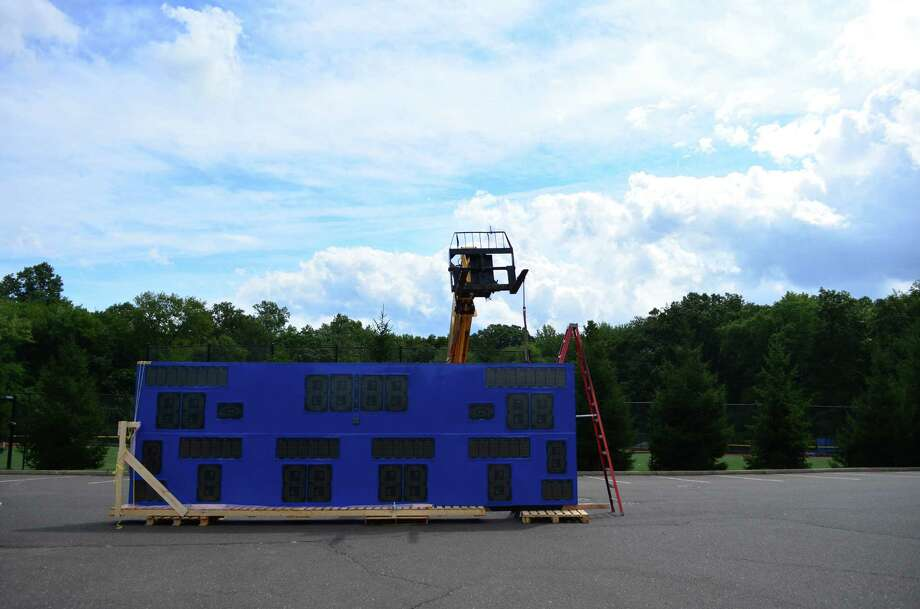 The new scoreboard, which was purchased by the newly formed Darien Athletic Foundation for $250,000, was installed on Thursday, Sept. 5 at the high school stadium. A video screen will be affixed to the top of the board that will allow for instant replay and other video functions. Photo: Megan Spicer