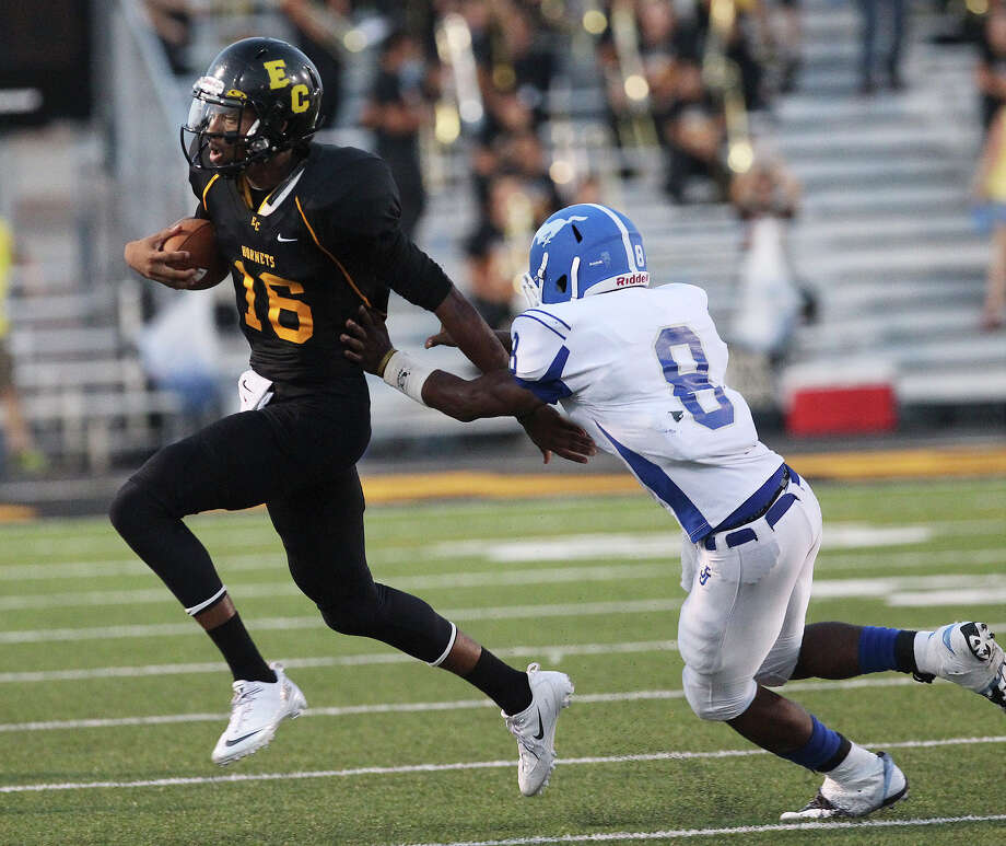 East Central's Jeremy Jones (16) attempts to scramble from John Jay's Josh Williams (08) during their game at East Central on Friday, Aug. 30, 2013. Photo: Kin Man Hui, San Antonio Express-News / ©2013 San Antonio Express-News