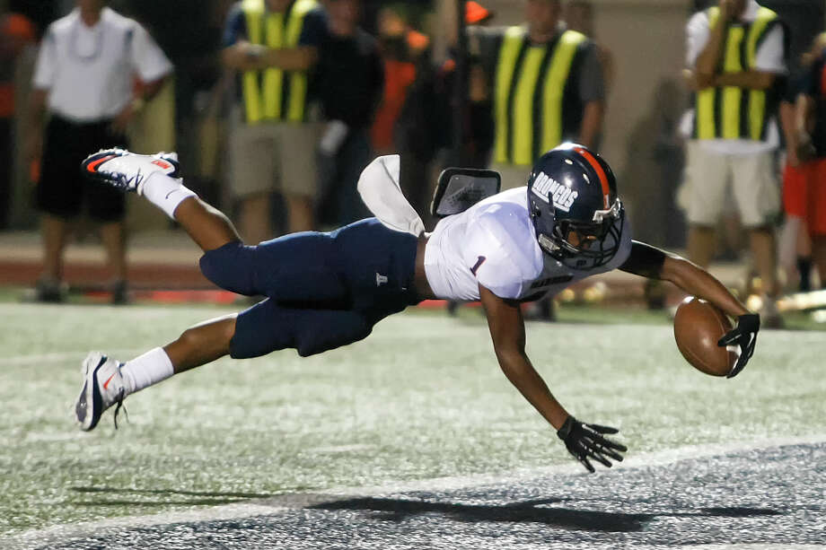 Brandeis's Derek Dennard crosses the goal line for a six-yard touchdown during the second quarter of their game with Smithson Valley at Ranger Stadium on Friday, Aug. 30, 2013.  Smithson Valley beat the Broncos 31-12.  MARVIN PFEIFFER/ mpfeiffer@express-news.net Photo: MARVIN PFEIFFER, San Antonio Express-News / Express-News 2013