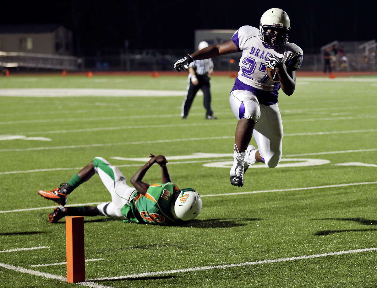 Brackenridge's Brandon Toston heads to the end zone for a touchdown over Sam Houston's Taveon Jones during second half action Friday Aug. 30, 2013 at the Wheatley Heights Sports Complex. Brackenridge won 63-0
