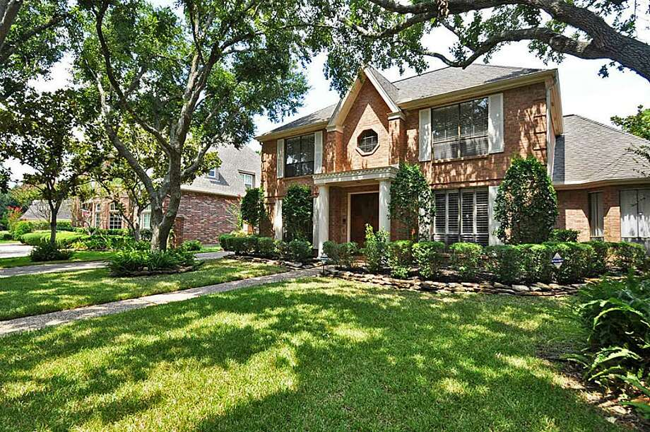 Built in 1984, this red brick, two-story home is located in a comfortable cul-de-sac lot. Photo: Realty Pros Of Texas