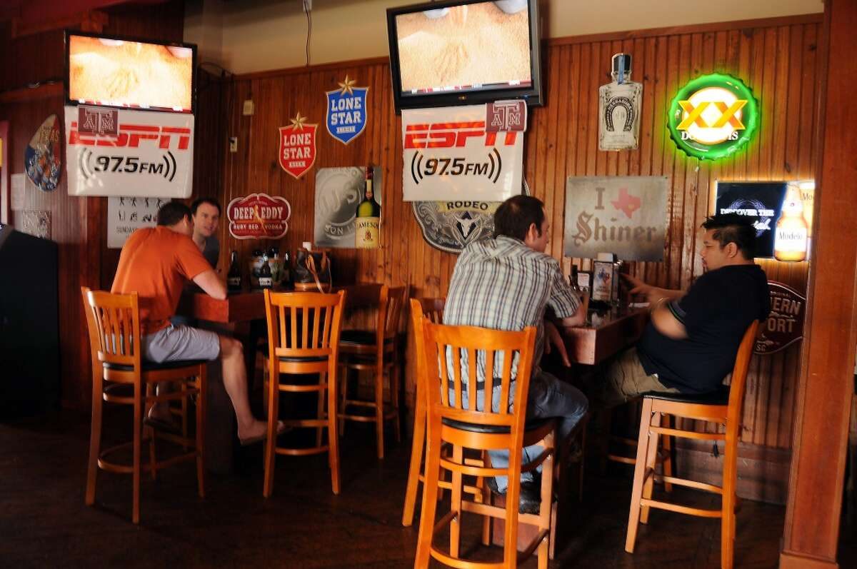 Fans watch college football games at Luke's Icehouse.