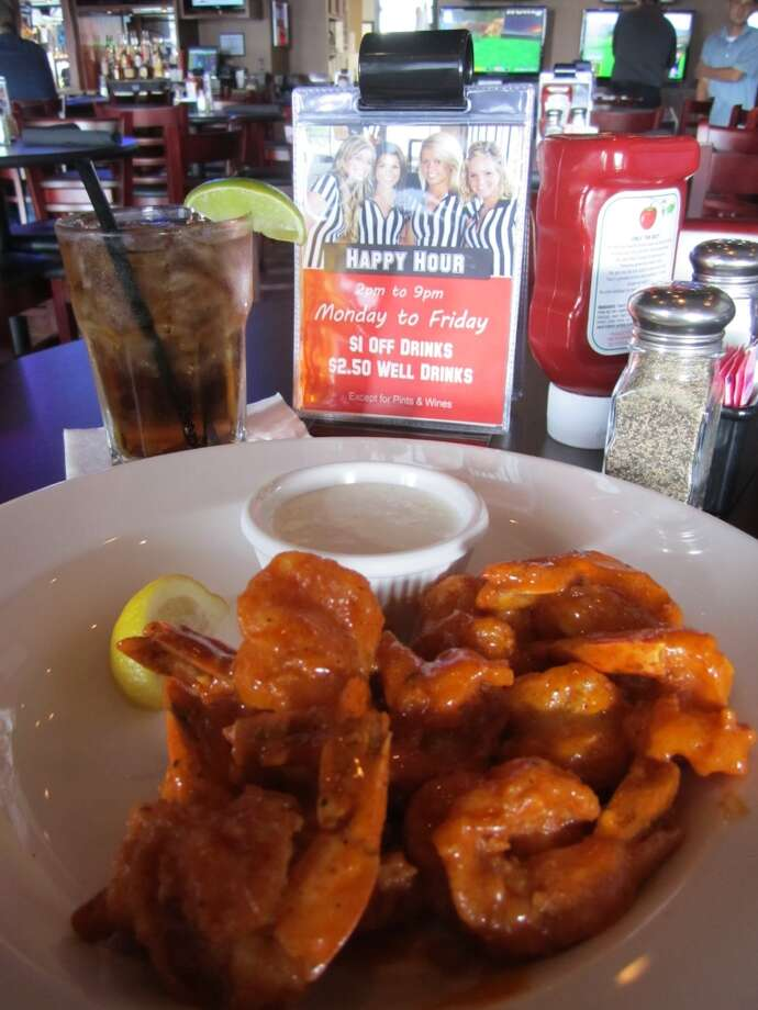 The burgers at Stadia Sports Grill are great, but the Buffalo shrimp is pretty good too. Photo: Syd Kearney, Houston Chronicle