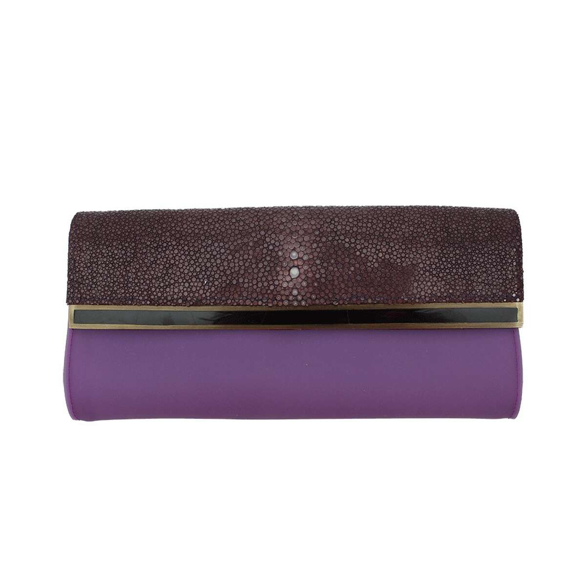 ABOVE THE FOLD Parisian designers R&Y Augousti specialize in exotic materials, such as the purple stingray leather on this sleek fold-over envelope clutch; $515 atfarfetch.com.