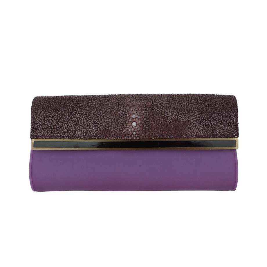 ABOVE THE FOLDParisian designers R&Y Augousti specialize in exotic materials, such as the purple stingray leather on this sleek fold-over envelope clutch; $515 at farfetch.com.