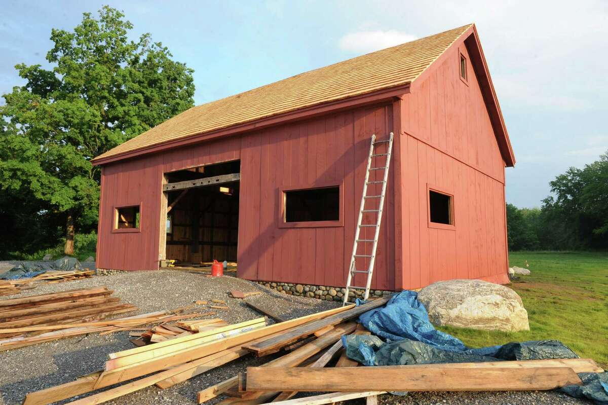 Exterior of Peter Brooks's barn on Tuesday, June 25, 2013 in Malta, N.Y. Wood has been installed in the 200-year-old barn which is being put together with original materials. (Lori Van Buren / Times Union)