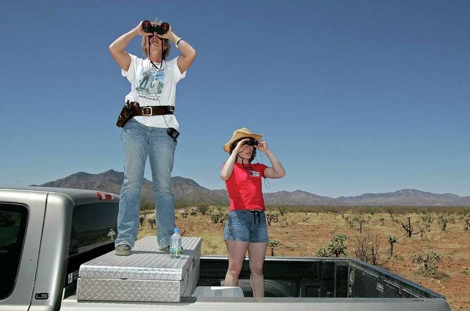Two female Minutemen patrol the Arizona desert in 2006. Photo: File Photo, Associated Press
