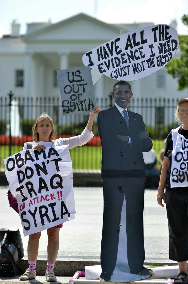 Demonstrators protest in front of the White House Tuesday against a possible U.S. attack on Syria. Photo: Jewel Samad / Getty Images