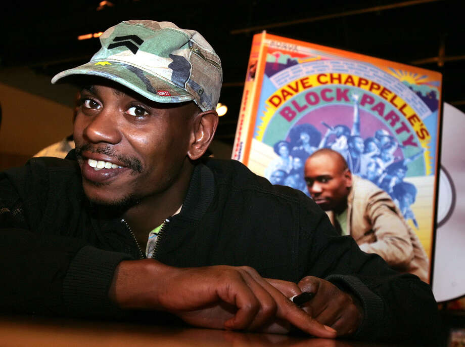"FILE - In this June 13, 2006 file photo, comedian Dave Chappelle promotes the release of his new DVD ""Dave Chappelle's Block Party,"" at the Virgin Megastore in Los Angeles. Chappelle has struck back at Hartford five days after he was heckled at a show and refused to perform his set. According to audio posted on TMZ.com, Chappelle praises an audience in Chicago on Tuesday for being ""so much better than Hartford."" He tells the crowd that if North Korea were to drop a bomb on the U.S., he hopes it ""lands in Hartford, Connecticut."" Chappelle was the headliner last Thursday in Hartford at the Funny or Die Presents The Oddball Comedy & Curiosity Festival, which is touring the country. (AP Photo/Stefano Paltera, File) ORG XMIT: NYET182 Photo: Stefano Paltera / AP"