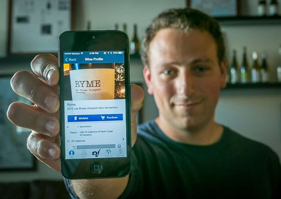 Delectable CEO Alex Fishman with his wine app, which offers elements of Instagram and Facebook. Photo: John Storey, Special To The Chronicle