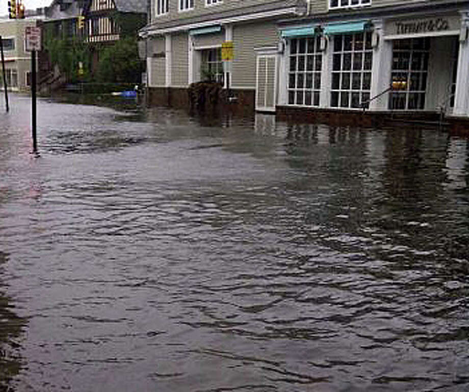 Severe flooding has hit Westport in the last two years -- shown here downtown during Tropical Storm Irene two years ago and again during Superstorm Sandy last year. Photo: File Photo / Westport News
