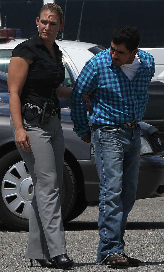 Detective Teresa Christensen of the Bexar County Sheriff's Office escorts animal cruelty suspect Guadalupe Sanchez at the Magistrate's Office Thursday September 5, 2013. Sanchez is facing multiple counts of livestock animal cruelty charges after horses in poor condition were found Sunday at a property on the 2700 block of Oak Island Drive. Photo: JOHN DAVENPORT, SAN ANTONIO EXPRESS-NEWS / ©San Antonio Express-News/Photo may be sold to the public