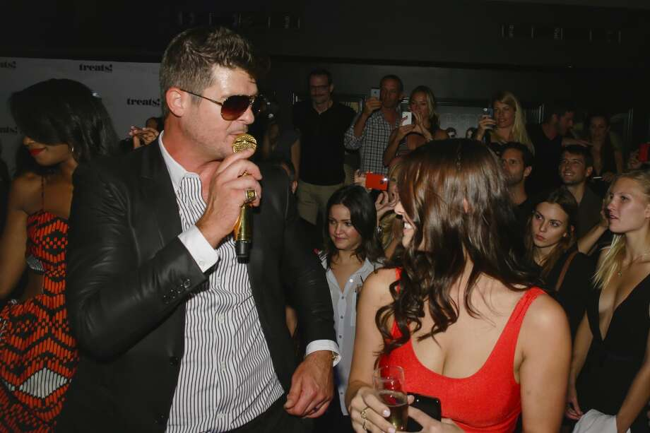 Robin Thicke performs at Robin Thicke's Album Release Party at No. 8 on September 4, 2013 in New York City.  (Photo by Andrew Toth/WireImage) Photo: Andrew Toth, WireImage
