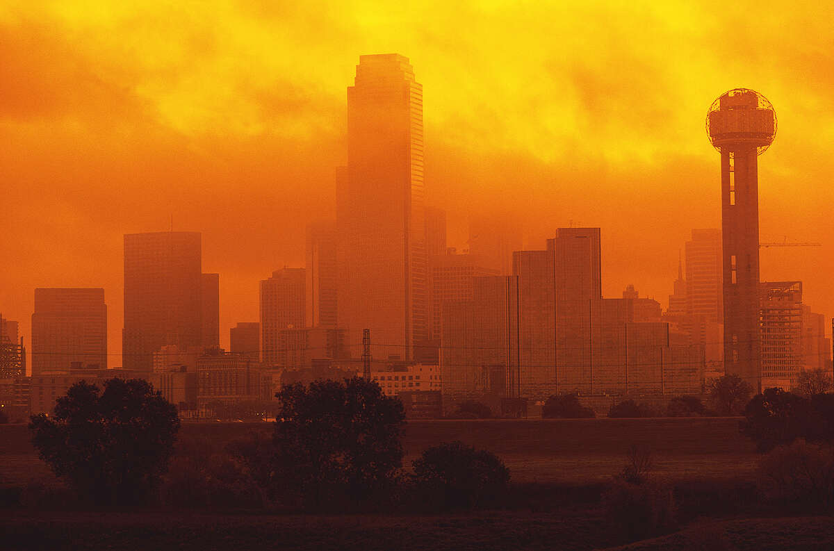 """""""The evidence that humans are damaging their ecological life-support system is overwhelming,"""" said a report by the Millennium Alliance for Humanity and the Biosphere at Stanford. Here, smog blankets Dallas."""
