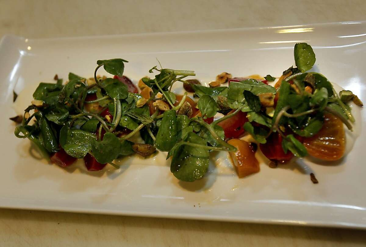 Beets with watercress makes a homegrown salad Monday August 19, 2013. Poggio chef Ben Balesteri works from a restaurant garden located on a hillside above the popular Sausalito, Calif. restaurant.