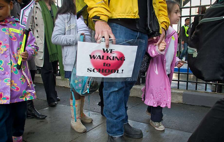A father walks with his daughter to Marshall School in San Francisco on International Walk to School Day in October 2011. Photo: John Storey, Special To The Chronicle