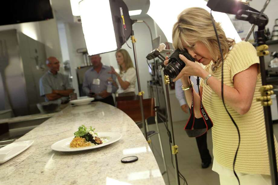 On www.goodtaste.tv, Tanji Patton explores food and wine. Here, the former TV journalist photographs the Chile Relleno Rustico cooked up by Iron Cactus chef Jaime Alexander Chozet. Photo: Helen L. Montoya / San Antonio Express-News