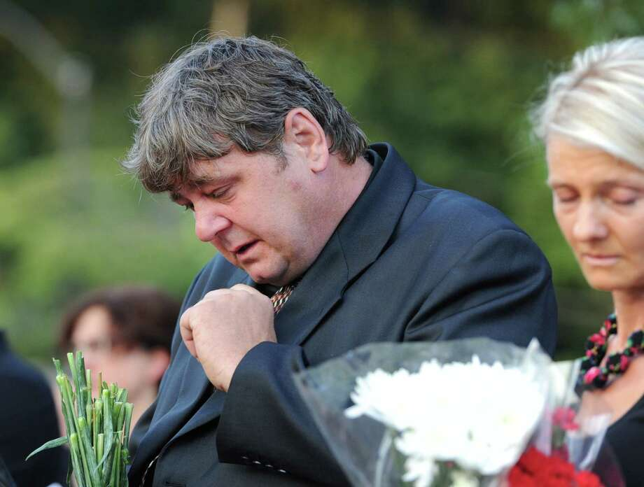 Franciszek Palosz during the Vigil Prayer Service for his son, Bart Palosz, at Greenwich High School, Tuesday night, Sept. 10, 2013. Palosz committed suicide after attending the first day of classes as a sophomore at Greenwich High school. The Palosz family says the suicide is the result of school bullying over a period of years. Photo: Bob Luckey / Greenwich Time