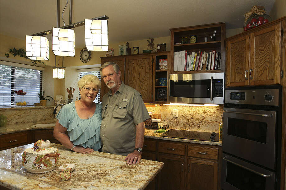 DiAnne Ramsbacher-Ross and husband David have made changes in their kitchen that emphasize workability, good looks and natural lighting. Photo: Kin Man Hui / San Antonio Express-News