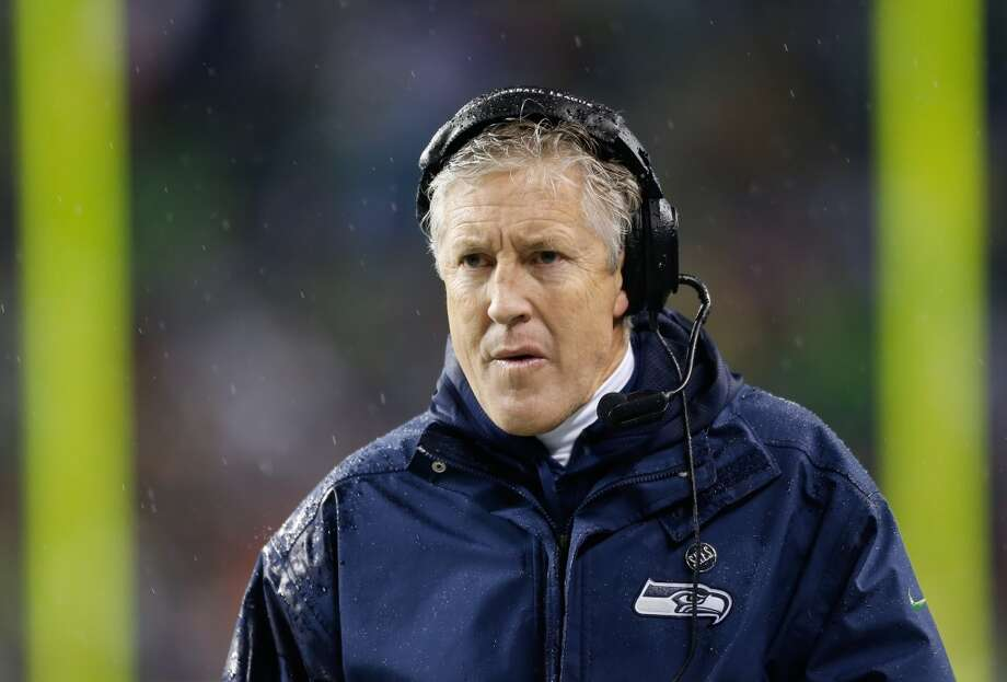 9. The Pete Carroll doctrine  Since arriving in 2010, head coach Pete Carroll has instilled a new philosophy in the Seahawks' locker room -- a doctrine relatively unique to Seattle. Carroll's mantra, ''Always compete,'' is emblazoned on walls throughout the VMAC in Renton, and he applies it en force when building his roster and choosing starters. Despite a perhaps erroneous reputation as a players' coach, Carroll doesn't shy from starting a rookie if he deserves it (see: Russell Wilson in 2012) or from cutting a veteran if he no longer fits (see: Michael Robinson last weekend). Then there's the accepting and almost-nurturing attitude Seattle's coaches and staff have toward their players. It's a new kind of coaching in the NFL, and it seems to be working. Photo: Otto Greule Jr, Getty Images