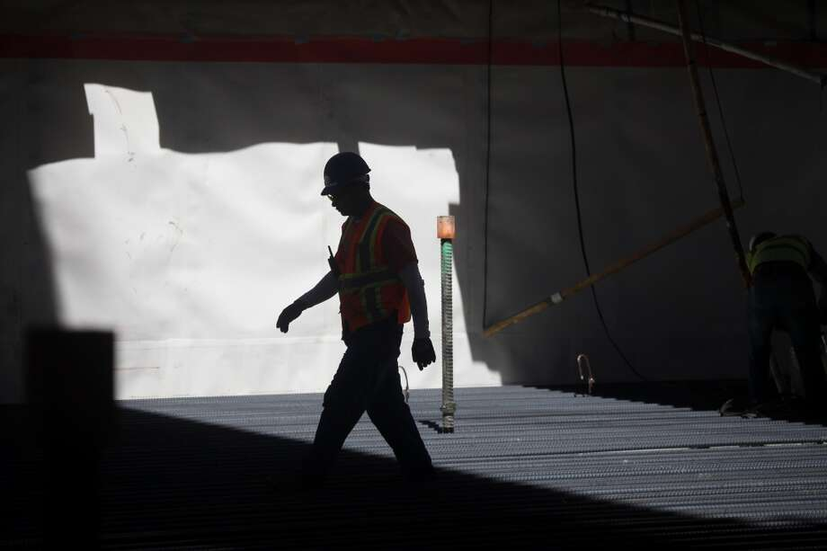 A worker is seen working in the train box in Zone 2 during a tour after the Transbay Transit Center Milestone Foundation Pour event on Thursday, September 5, 2013 in San Francisco, Calif. Photo: The Chronicle