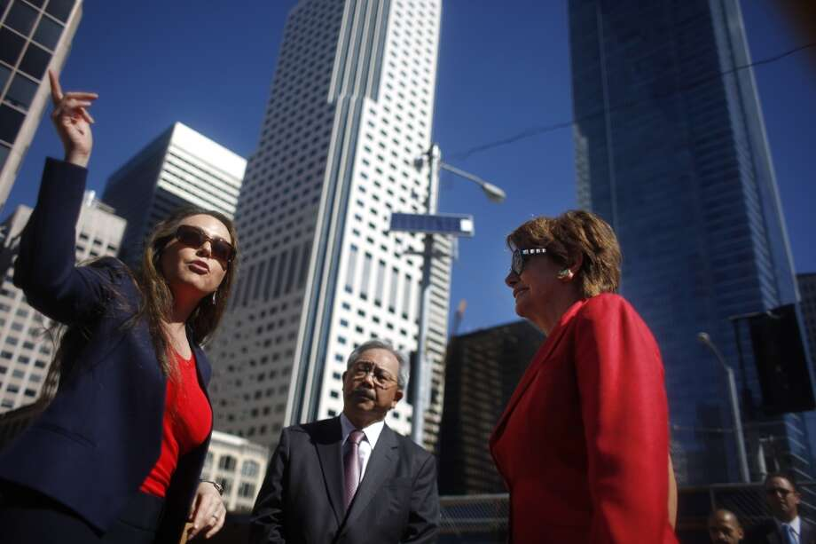 Maria Ayerdi-Kaplan (l to r), Transbay Transit Center executive director; talks with San Francisco Mayor Ed Lee and House Democratic Leader Nancy Pelosi at the Transbay Transit Center Milestone Foundation Pour event on Thursday, September 5, 2013 in San Francisco, Calif. Photo: The Chronicle