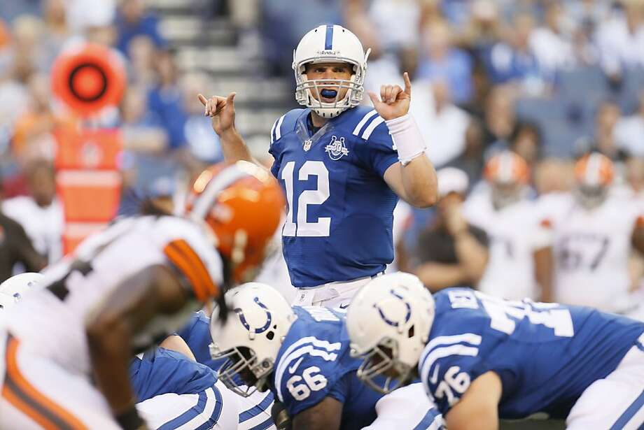 Andrew Luck passed for 4,374 yards last season but also was knocked down 122 times. Photo: AJ Mast, Associated Press