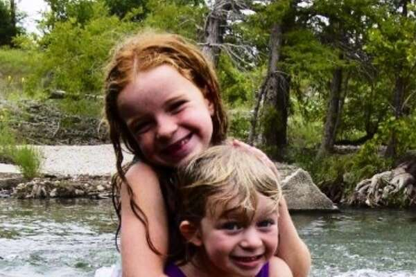 Sisters Andie (left) and Griffin Foultz play in the Guadalupe River near Hunt back in 2001.