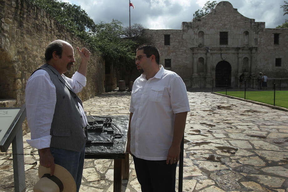 Daniel Rush (right) listens as Alamo Historian and Curator Bruce Winders (left) gives a personalized tour of the Alamo Monday August 26, 2013. Rush, who was born and raised in San Antonio and works downtown, had never toured the Alamo before. Photo: SAN ANTONIO EXPRESS-NEWS / ©San Antonio Express-News/Photo may be sold to the public