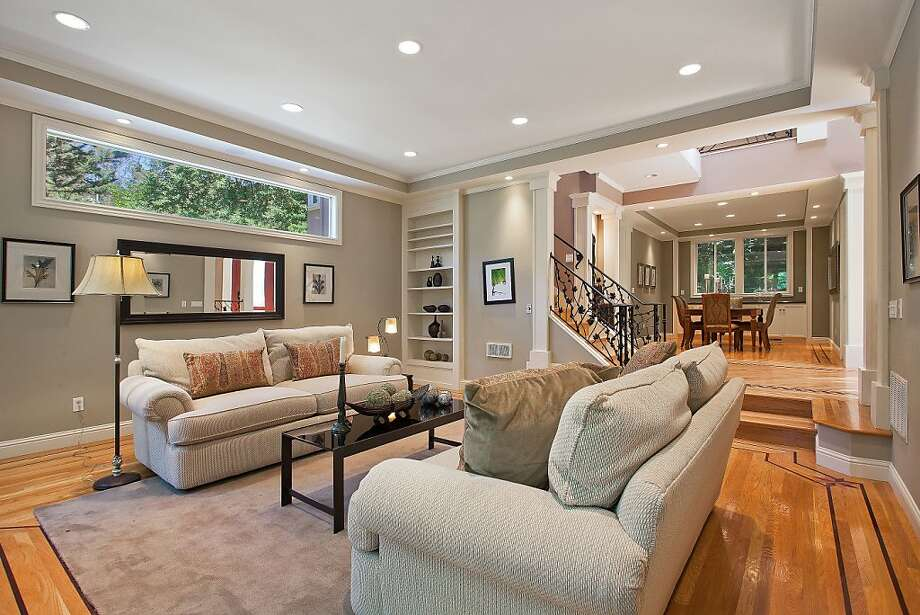 Soffit ceilings, detailed hardwood floors and built-in shelving are among the custom finishes found throughout 30 White Court in Montclair. Photo: OpenHomesPhotography.com