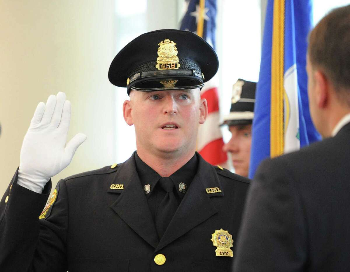 Greenwich Police Officer Ernest Mulhern is sworn in as a Sergeant by Greenwich First Selectman Peter Tesei during a promotion ceremony for Mulhern at Greenwich Police Headquarters, Thursday, Sept. 5, 2013.
