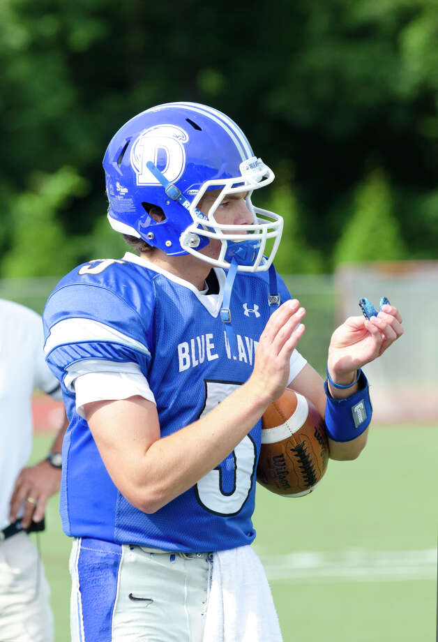 during a football scrimmage against Brien McMahon High School hosted at Darien High School on Thursday, Sept. 5, 2013. Photo: Amy Mortensen / Connecticut Post Freelance