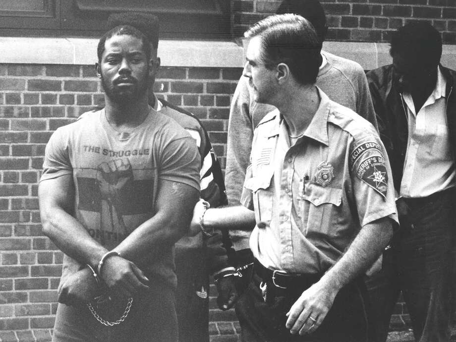 Bernard Williams, accused of murdering a woman in the Bloomingdale's parking lot in June 1988, is led into state Superior Court in Stamford on Sept. 9, 1988. Photo: Advocate