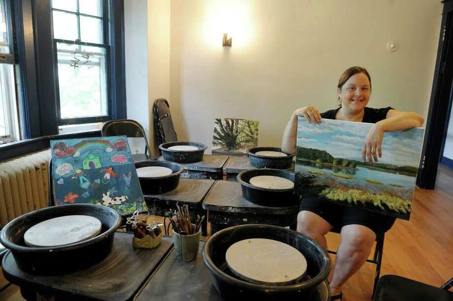 Karen Schupack, owner of Albany Art Room, holds one of her paintings as she sits in the room with pottery wheels at her new location at 350 New Scotland Ave. Thursday, Sept. 5, 2013, in Albany, N.Y.  Schupack expects to have the business opened by the middle of October.  Schupack is a graduate of the Albany-Colonie Regional Chamber's Entrepreneur Boot Camp program for people looking to start their own business.  (Paul Buckowski / Times Union) Photo: Paul Buckowski / 00023765A