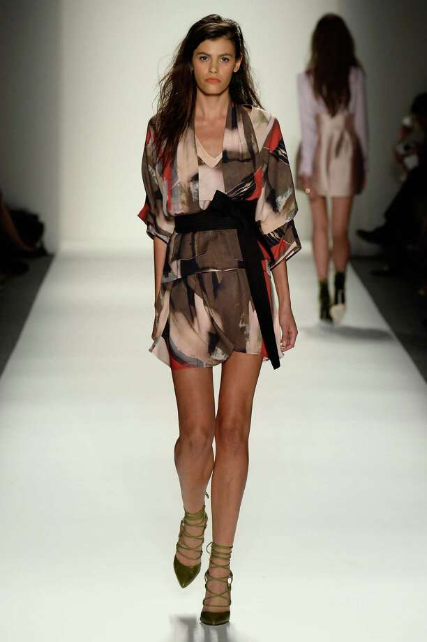 A model walks the runway during the Marissa Webb Spring 2014 fashion show at Mercedes-Benz Fashion Week Spring 2014 - Official Coverage - Best Of Runway Day 1 on September 5, 2013 in New York City. Photo: Frazer Harrison, Getty Images For Mercedes-Benz / 2013 Getty Images