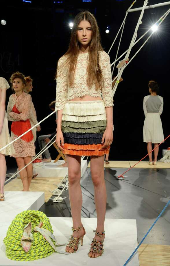 A model walks the runway during the Candela Spring 2014 fashion presentation at Mercedes-Benz Fashion Week Spring 2014 - Official Coverage - Best Of Runway Day 1 on September 5, 2013 in New York City. Photo: Fernanda Calfat, Getty Images For Mercedes-Benz / 2013 Getty Images