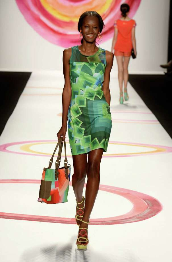 A model walks the runway during the Desigual Spring 2014 fashion show at Mercedes-Benz Fashion Week Spring 2014 - Official Coverage - Best Of Runway Day 1 on September 5, 2013 in New York City. Photo: Frazer Harrison, Getty Images For Mercedes-Benz / 2013 Getty Images