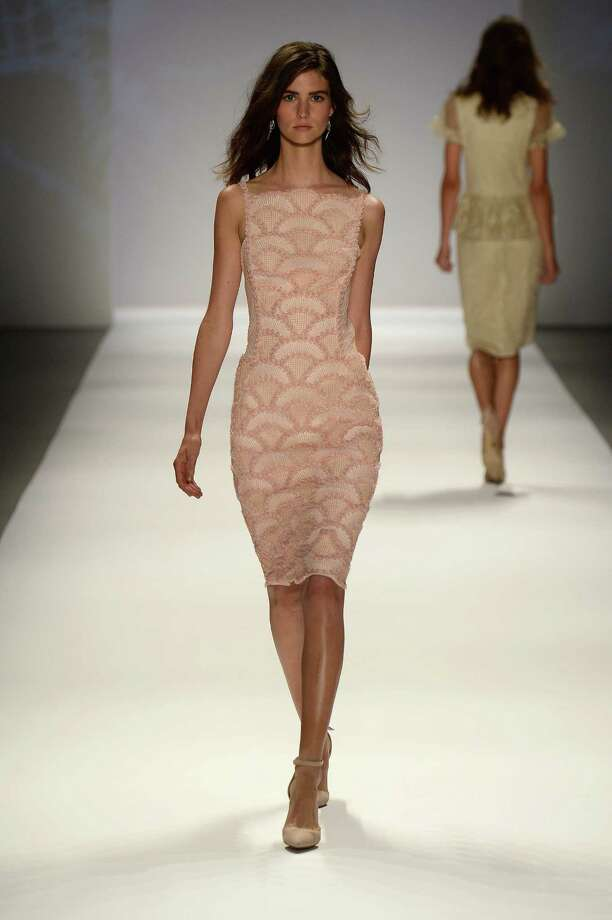 A model walks the runway during the Tadashi Shoji Spring 2014 fashion show at Mercedes-Benz Fashion Week Spring 2014 - Official Coverage - Best Of Runway Day 1 on September 5, 2013 in New York City. Photo: Frazer Harrison, Getty Images For Mercedes-Benz / 2013 Getty Images