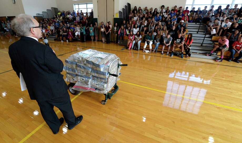 School Superintendent Michael Mugits stands near a carryall which contained over $380,000 was used Thursday Spet. 5, 2013, to show student at Heatly School in Green Island, N.Y., how much they would lose if they dropped out of school. ( Skip Dickstein/Times Union ) Photo: Skip Dickstein / 00023758A