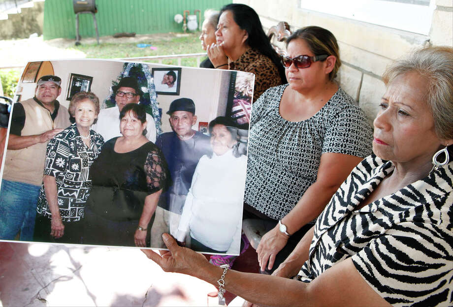 Andrea Sanchez (from right), Beatrice Mosqueda, Maria Medina, and Connie Almaras, the sisters of Juan Rangel Martinez, 70, speak about their loved one Sept. 5, 2013 as Sanchez holds a photo of them with Martinez (second from right). Martinez was killed earlier this week by a bus and the family will be holding a fundraiser to help pay for their brother's burial. There will be a plate sale of chicken, sausage, rice, beans, and potato salad on Sept. 6 starting at 11a.m. at 909 Dakota for $6 each. Photo: Cynthia Esparza, For The San Antonio Express-News / SAN ANTONIO EXPRESS-NEWS