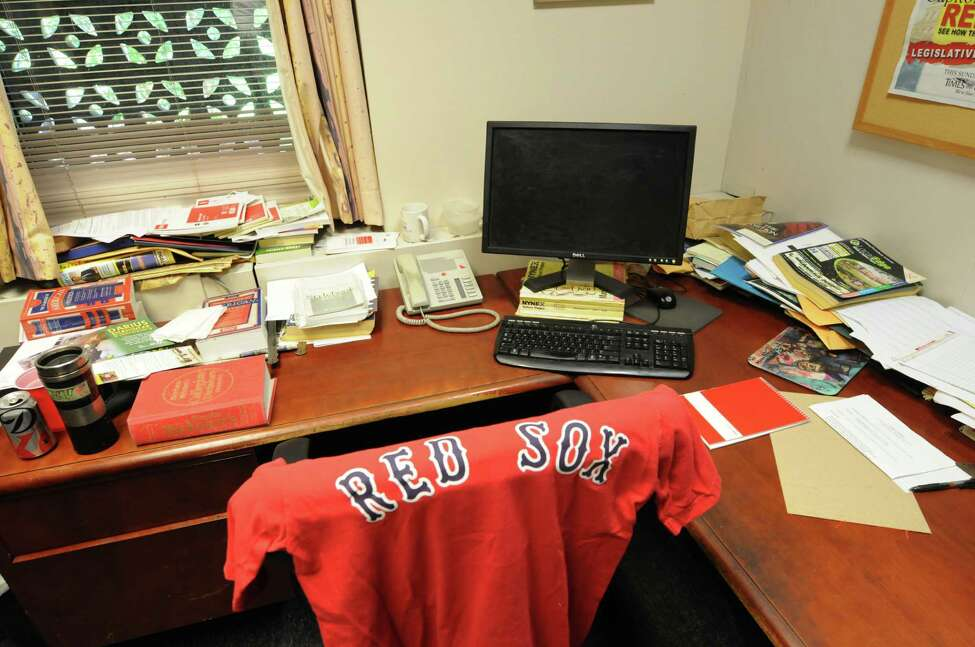 Jim McGrath's empty desk is seen Thursday, Sept. 5, 2013, in his office at the Times Union in Colonie, N.Y. McGrath died Wednesday while on vacation in Cape Cod, Mass. (Will Waldron/Times Union)