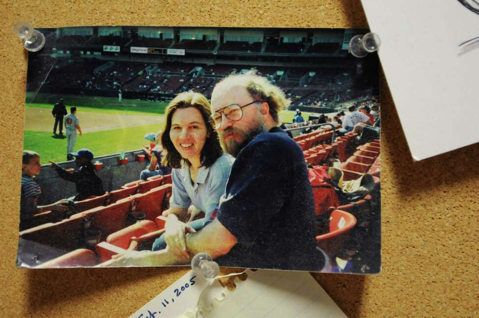 A photo of Jim McGrath with his wife Darryl hangs on a message board in McGrath's office Thursday, Sept. 5, 2013, at the Times Union in Colonie, N.Y. Jim McGrath died Wednesday while on vacation in Cape Cod, Mass. (Will Waldron/Times Union)