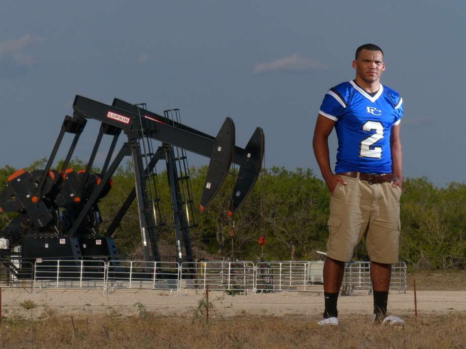 Already a star in East Texas, Justin Twine has moved to Falls City, which is located in an energy-rich area of Texas. Sept. 5, 2013. Photo: Billy Calzada, San Antonio Express-News / San Antonio Express-News