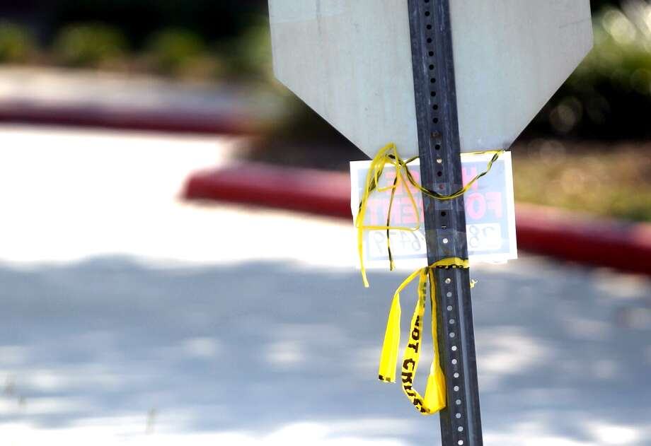 Crime scene tape hangs from a stop sign outside of Spring High School on the morning of Thursday, Sept. 5, 2013 – one day after a stabbing at the school left one student dead and three others injured. Photo: Johnny Hanson, Houston Chronicle