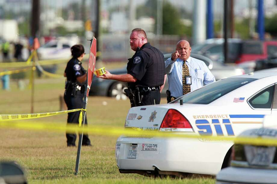 Spring ISD police secure the front of Spring High School as investigators continue to arrive on Wednesday, Sept. 4, 2013, in Spring. Harris County Sheriff's Office is investigating. Photo: Mayra Beltran, Houston Chronicle / © 2013 Houston Chronicle
