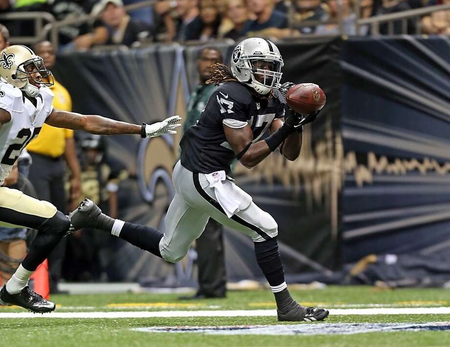 Oakland hopes for big plays from Denarius Moore, shown catching a TD pass against the Saints in the second preseason game. Photo: Layne Murdoch, Associated Press